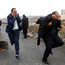 Palestinian lawyers run during clashes with Israeli troops at a protest near the Jewish settlement of Beit El. Photo: Reuters