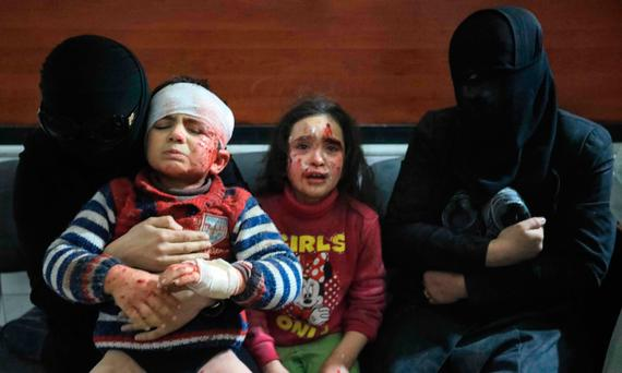Wounded Syrians await treatment at a clinic in Hamouria, in Eastern Ghouta. Photo: Abdullah Hammam/AFP/Getty Images