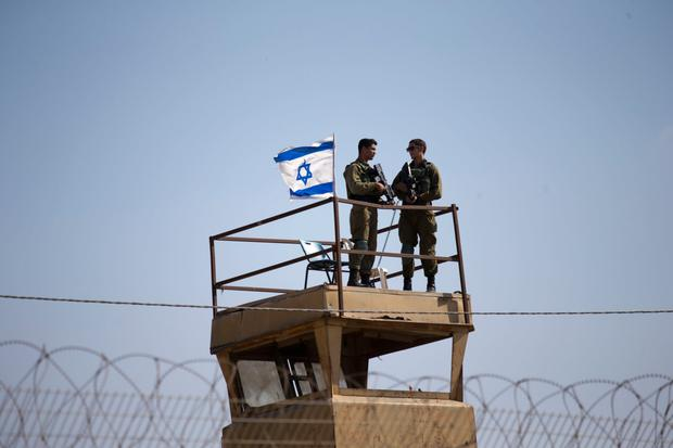 Israeli soldiers guard on top of a watch tower in a community along the Israel-Gaza border. Photo: AP