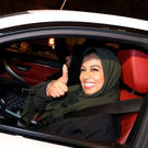 A Saudi woman celebrates as she drives her car in her neighbourhood, in Al Khobar, Saudi Arabia. Photo: Reuters