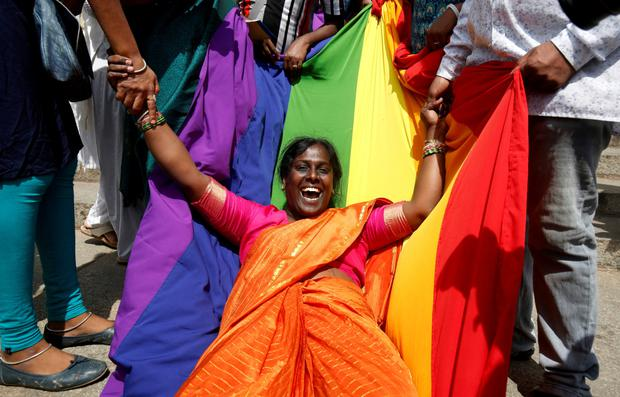 An LGBT activist celebrates the Supreme Court's verdict. Photo: REUTERS/Abhishek N. Chinnappa