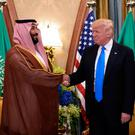 Handshake: US President Donald Trump with and Saudi Crown Prince Mohammad bin Salman in Riyadh in May last year. Photo: GETTY