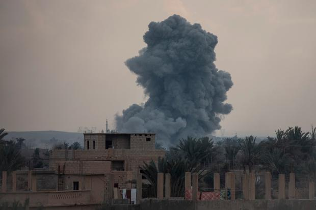 Smoke: An explosion on the frontline in Bagouz, Syria. Photo: Getty Images