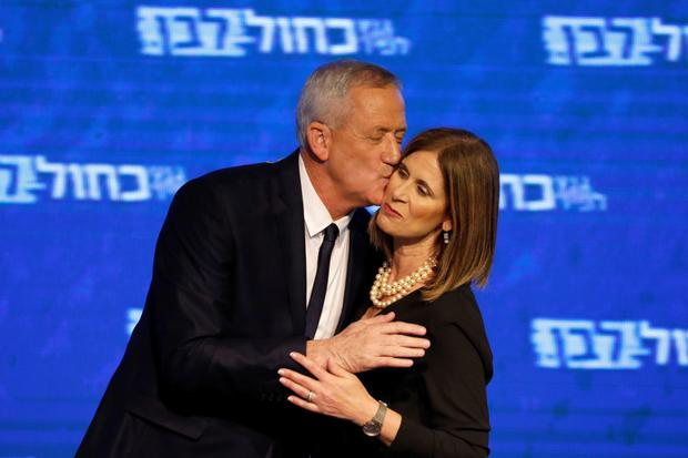 Happy: Benny Gantz kisses his wife Revital before a speech in Tel Aviv after the release of exit polls. Photo: Reuters