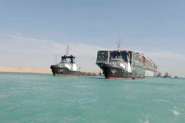 Ever Given accompanied by Suez Canal tugboats as it moves in the Suez Canal, Egypt. Photo: Suez Canal Authority via AP