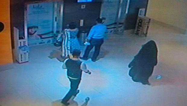 A CCTV image released by Abu Dhabi police on December 3, 2014 shows a fully veiled woman (R) walking in a shopping mall in the Emirati capital.