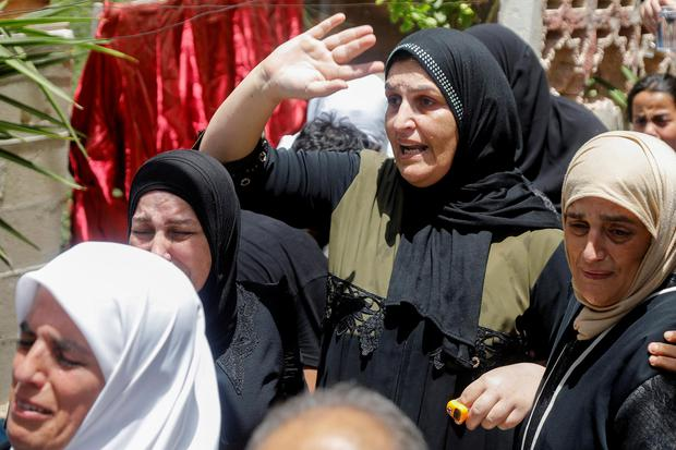 Relatives mourn at the funeral of one of the security men