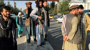 A member of Taliban stands outside Hamid Karzai International Airport in Kabul, Afghanistan. Picture: Reuters