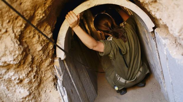 An Israeli soldier in the uncovered tunnel