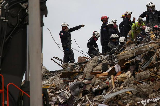 Rescue personnel continue the search and rescue operation for survivors at the site of a partially collapsed residential building in Surfside, near Miami Beach, Florida, U.S. June 30, 2021. REUTERS/Marco Bello