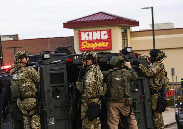 Law enforcement officers in tactical gear are seen at the site of a shooting at a King Soopers grocery store in Boulder, Colorado REUTERS/Kevin Mohatt