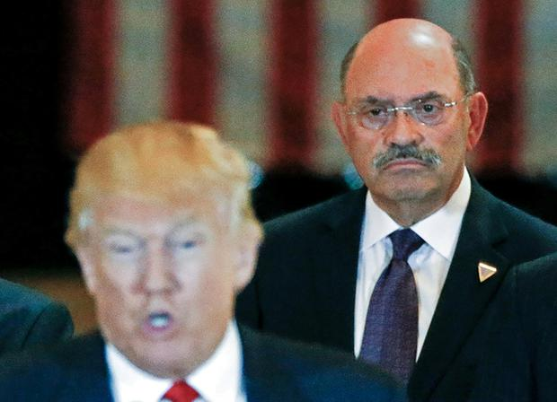 A file image shows Trump Organisation chief financial officer Allen Weisselberg looking on as Donald Trump speaks. Photo: Reuters