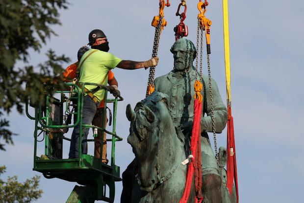 Workers remove a statue of Confederate General Robert E. Lee, after years of a legal battle over the contentious monument, in Charlottesville, Virginia. Picture: Reuters
