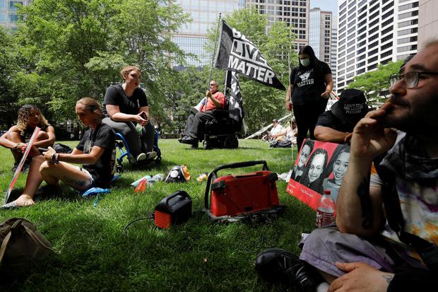 People listen to live stream of outside Hennepin County Government Center ahead of a sentence being pronounced on former police officer Derek Chauvin who was convicted for murdering George Floyd. (Pic: REUTERS/Nicholas Pfosi)