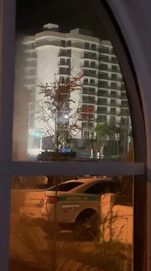 The partially collapsed Miami-area condo where 24 people are confirmed dead is seen before it was demolished, ahead of the possible arrival of Tropical Storm Elsa, July 4, 2021 in Surfside, Miami, Florida, U.S., in this still image taken from video, . Darrell Arnold /via REUTERS