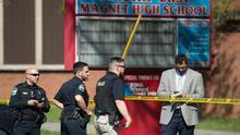 Law enforcement officers respond to a shooting at Austin-East Magnet High School in Knoxville, Tenn., Monday, April 12, 2021. Authorities say multiple people including a police officer have been shot at the school. (Saul Young/The News Sentinel via AP)