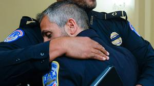 Police OfficerHarry Dunn (left) hugs officer Michael Fanone after the hearing in Washington into the Capitol insurrection.Photo: AP