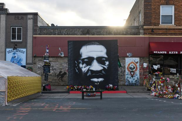 George Floyd Square is adorned with a poster of the man in front of the place where he died in Minneapolis. Photo: Nicholas Pfosi/Reuters