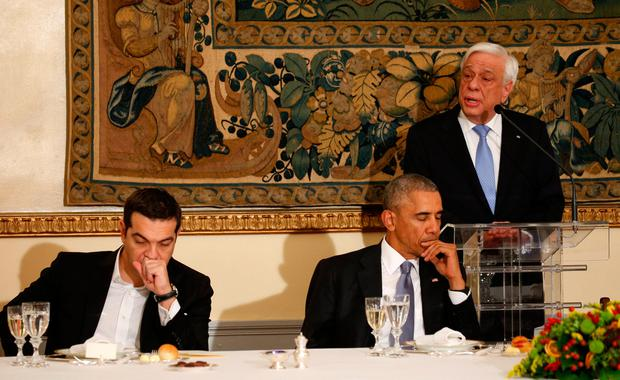 U.S. President Barack Obama and Greek Prime Minister Alexis Tsipras listen as Greek President Prokopis Pavlopoulos speaks during a state dinner in Obama's honor at the Presidential Mansion in Athens, Greece November 15. Photo: REUTERS/Kevin Lamarque
