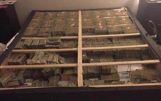 $20m under a mattress was discovered at an apartment in Massachusetts Credit: U.S. Attorney MA / Twitter