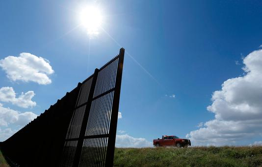 Mexico border fence that passes through his property in Brownsville, Texas. Photo: AP Photo/Eric Gay, File