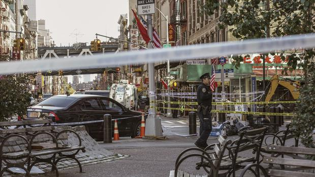 New York Police Department officers investigate the scene of an attack in Manhattan (Jeenah Moon/AP)