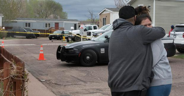 Family and friends of the victims who died in a shooting, comfort each down the street from the scene in Colorado Springs, Colorado PIC Jerilee Bennett/The Gazette via AP)