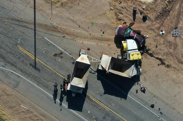 California Highway Patrol (CHP) officers investigate a crash site after a collision between a Ford Expedition sport utility vehicle (SUV) and a tractor-trailer truck near Holtville, California, U.S. in an aerial photograph March 2, 2021. REUTERS/Bing Guan