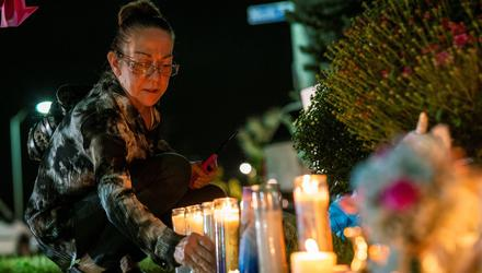 A woman lights candles during a vigil for travel blogger Gabby Petito in Blue Point, New York, on September 24, 2021. Picture by Reuters/Eduardo Munoz