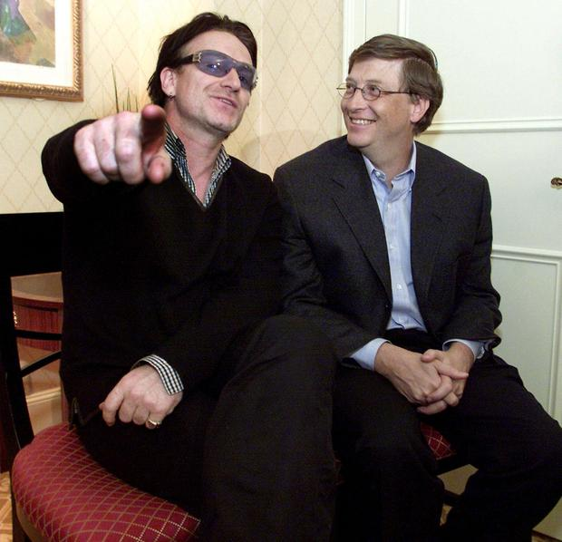 Bono and Bill Gates at a World Economic Forum news conference in 2002. Photo: Jeff Christensen/ getty images