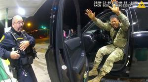 U.S. Army 2nd Lieutenant Caron Nazario exits his vehicle after being sprayed with a chemical agent by Windsor police officer Joe Gutierrez (L) at a gas station during a violent traffic stop in a still image from officer Daniel Crocker's body camera taken in Windsor, Virginia, U.S. May 12, 2020. Windsor Police/Handout via REUTERS