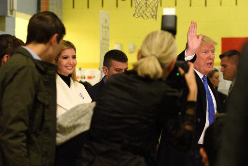 Republican presidential nominee Donald Trump, with daughter Ivanka Trump (L), waves after casting his vote for the U.S. presidential election in the Manhattan borough of New York, U.S. November 8, 2016. Photo: REUTERS/Darren Ornitz