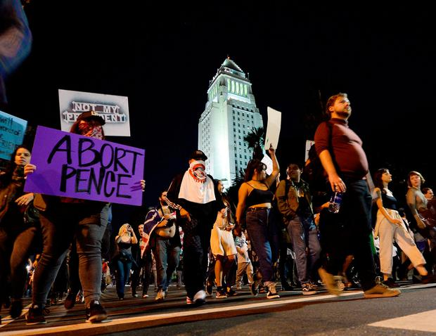 Protesters march in the streets of Downtown Los Angeles during march and rally against the election of Republican Donald Trump as President of the United States in Los Angeles, California. Photo: REUTERS/Kevork Djansezian